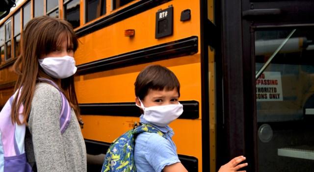 Image of girl, boy wearing masks to school during coronavirus