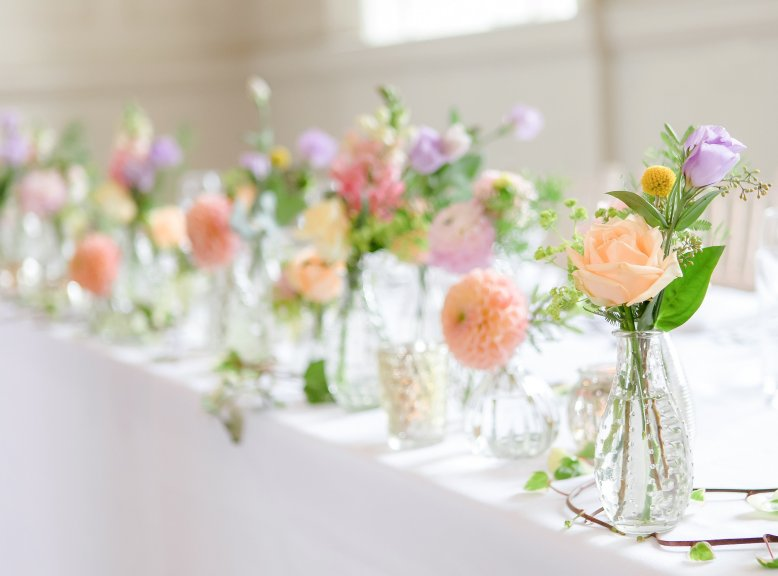 dainty vases filled with flowers