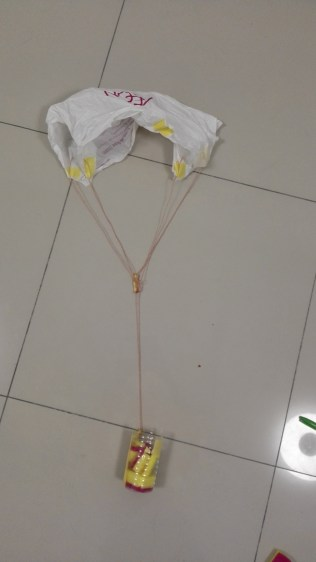 The parachute + egg container