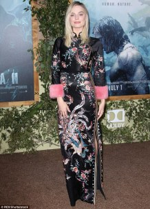 35BD36C200000578-3663289-Flawless_The_black_and_floral_dress_complimented_Margot_s_porcel-m-44_1467087677885