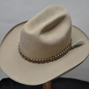 sahara cattleman hat with dark brown studded hatband and grey horsehair tail
