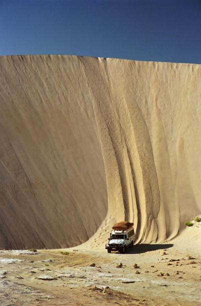 Driving down a sand dune in Lucky Bay, Australia
