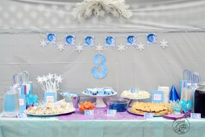 Throw a fabulous and frugal DIY Frozen Birthday party with these free printables, food, games and favor ideas!