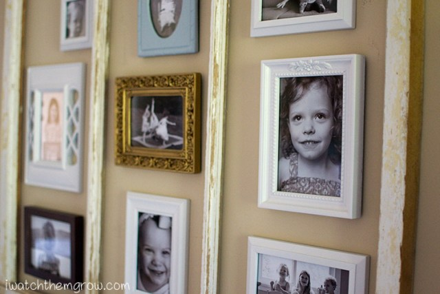 This old window frame photo collage is a perfect way to use a big window frame with no glass! The picture frames can be arranged however you want and can be any size or color so it's totally customizable to your space! This has to be the easiest designer photo collage for a non-designer!