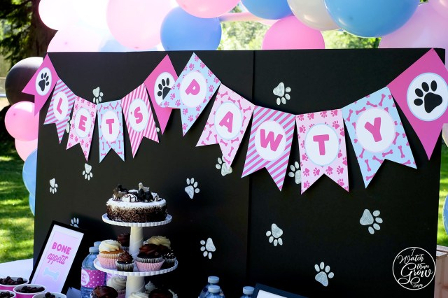 """Let's Pawty"" flag banner over a DIY faux chalkboard backdrop"