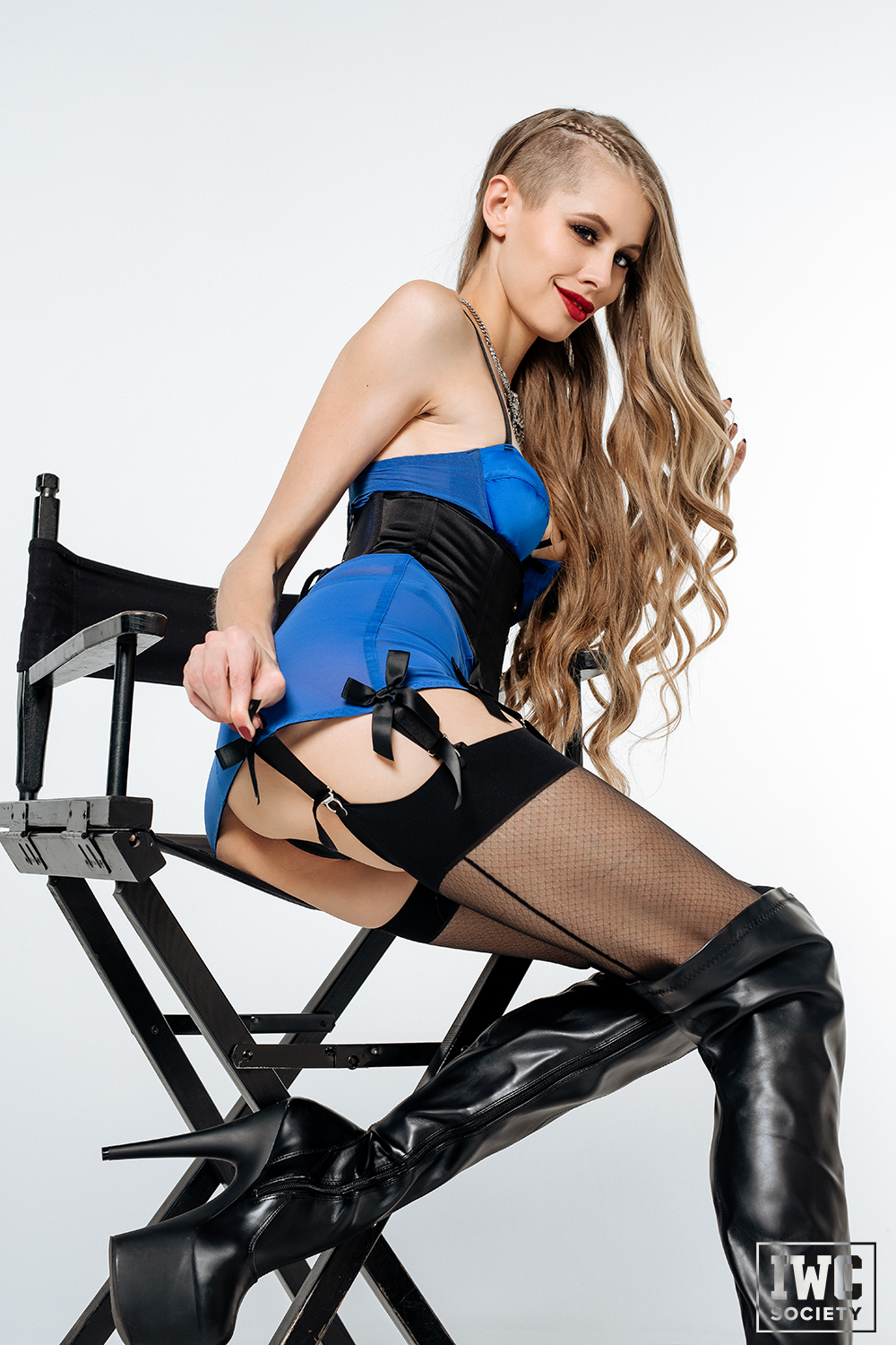 blonde dominatrix showing off her butt garters and long hair