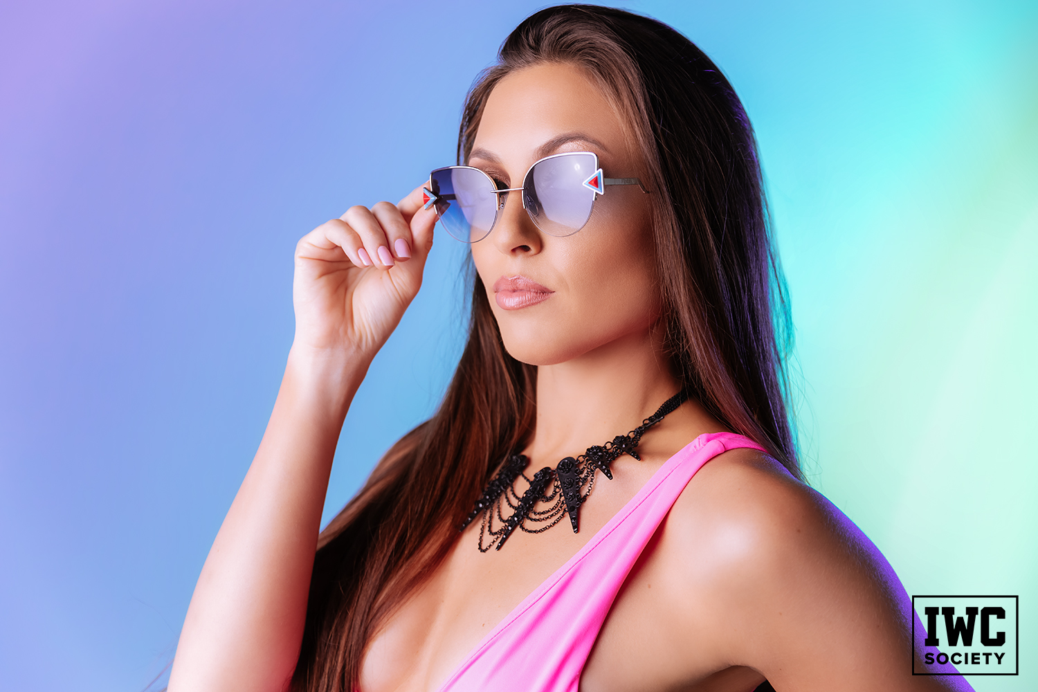 Slave Trainer with pink nails grabbing sunglasses