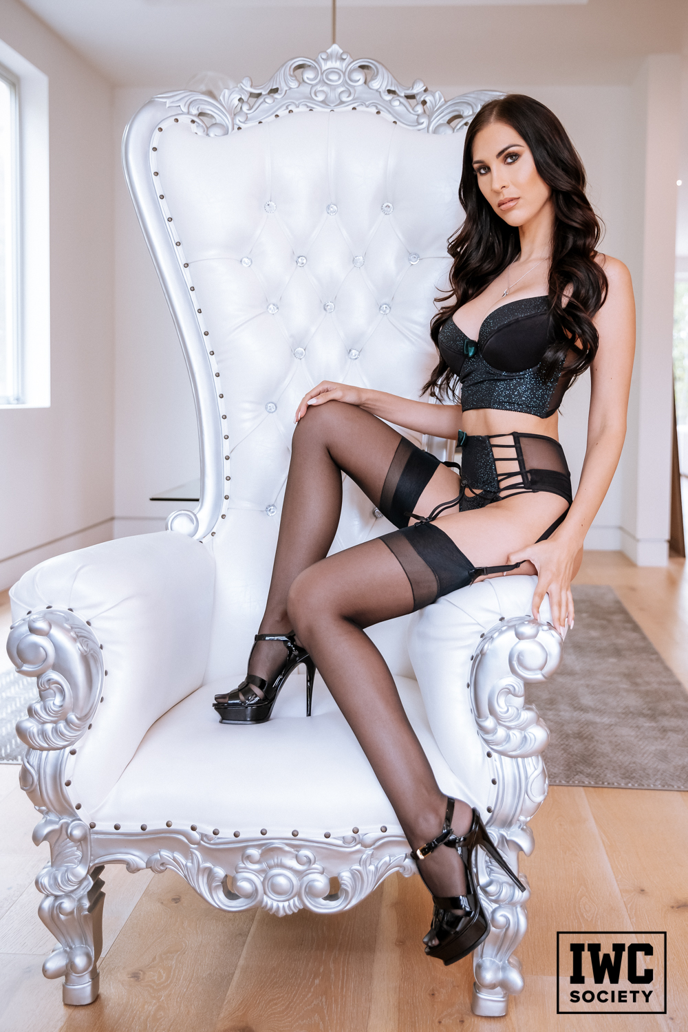 Princess Ashley perched on throne in black lingerie