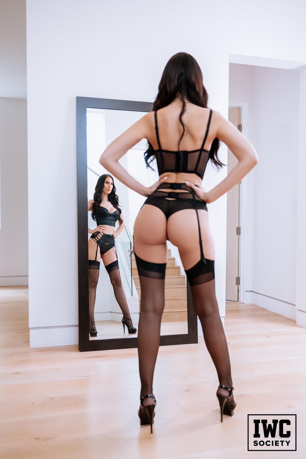 Princess Ashley looking in mirror in stockings and thong