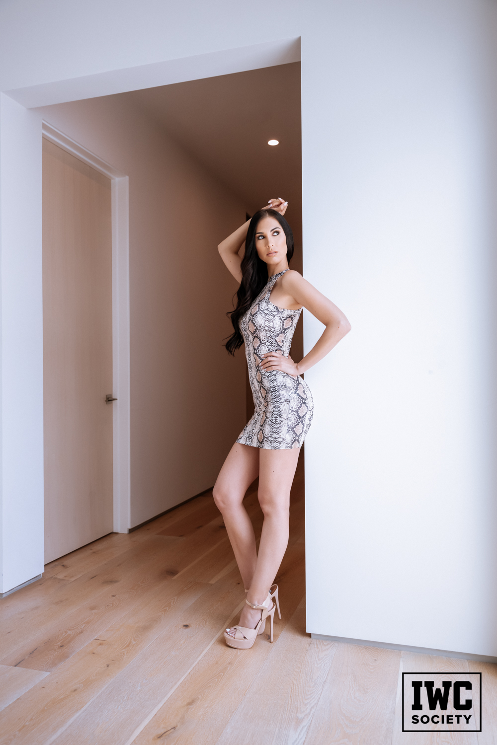 brunette financial dominatrix with long legs in heels