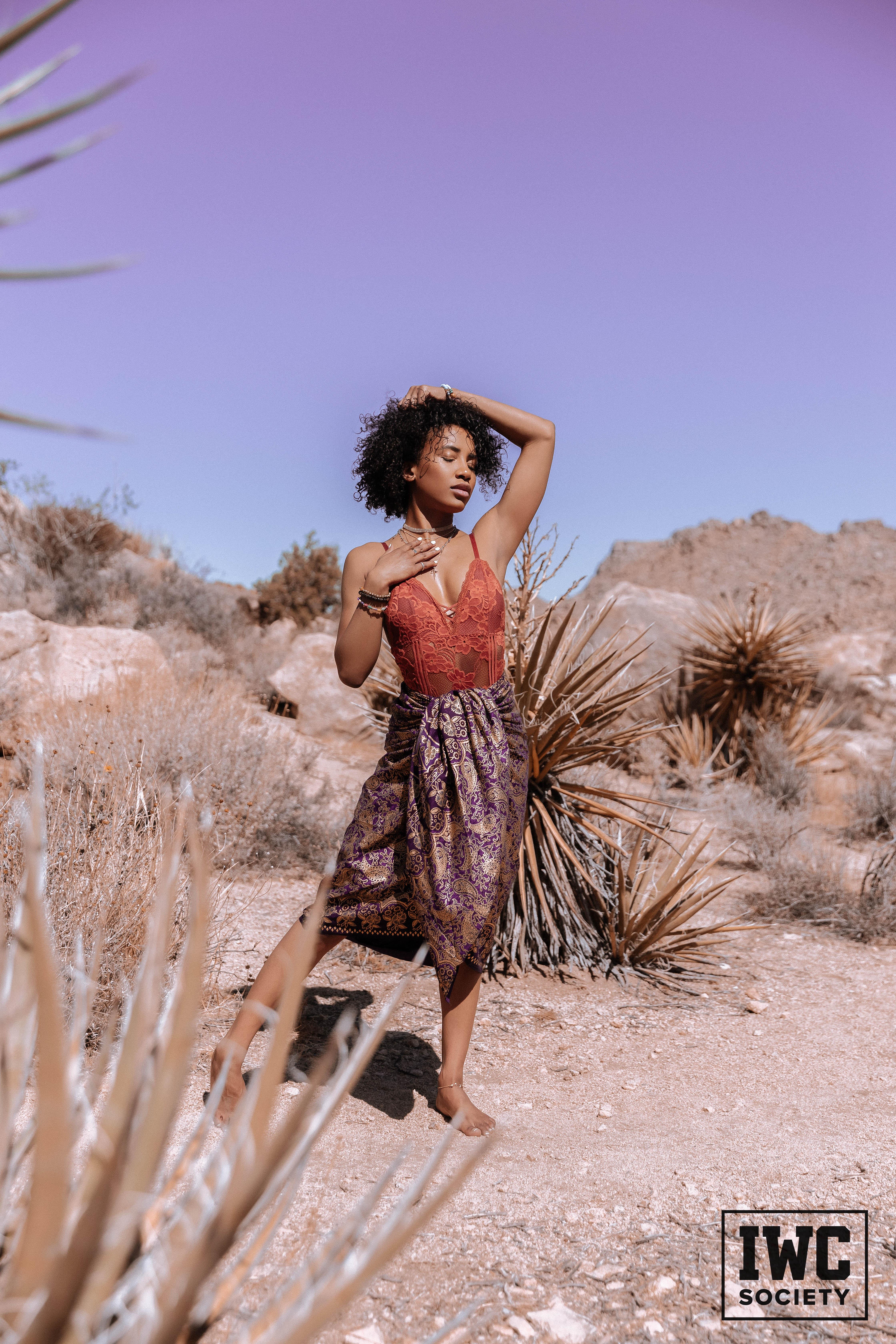 demi sutra barefoot in desert in skirt