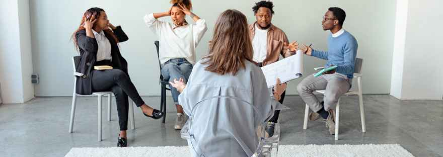 people in a psychotherapy session