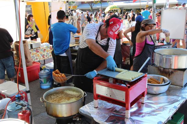 Frying churros in boiling oil at the Sasa on St. Clair festival