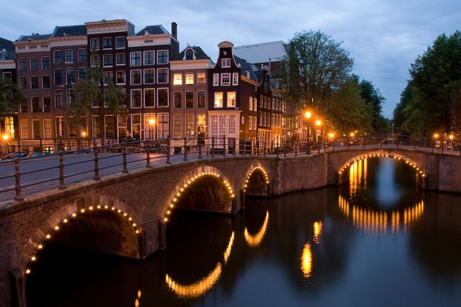 A view of the Reguliersgracht on the corner with the Keizersgracht at dusk.