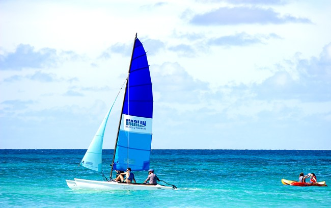 A couple of people sailing in the Caribbean ocean in Varadero, Cuba.