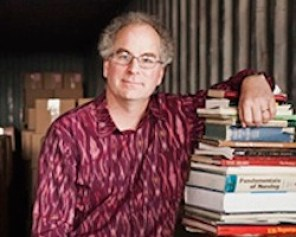 Brewster Kahle, founder of the Internet Archive, a nonprofit organization devoted to preserving Web pages, inside his repository for storing books in Richmond, Calif., Feb. 21, 2012. Kahle has started amassing physical texts in case they're needed for future digitization -- and because he abhors throwing them out. (Lianne Milton/The New York Times)