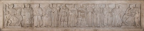 A frieze on the north wall of the U.S. Supreme Court depicts great lawgivers of the Middle Ages. Muhammad is standing second from the right between Justinian and Charlemagne, holding the Qur'an and a sword.