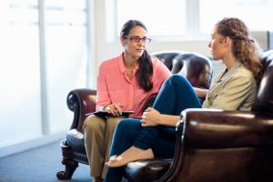 Psychologist having session with her patient