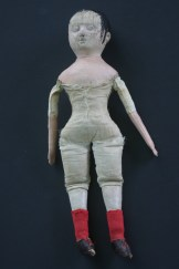 This is Lily when she first arrived at my studio. Note the missing paint on her facial features, the poorly made flat replacement arms, the glued on stockinette covering her original shoulders and the sewn on stockings and leather shoes.