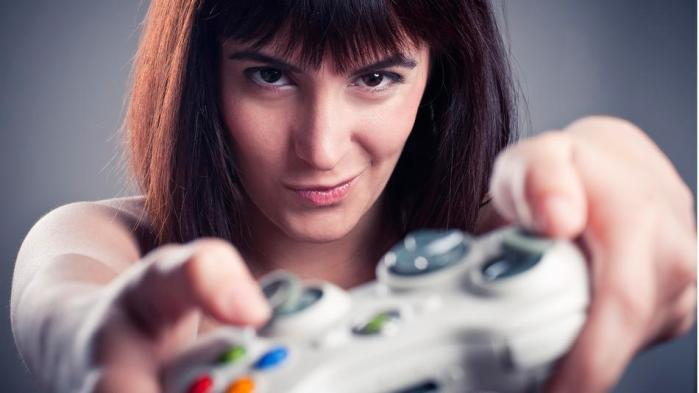 Girl playing videogames in a funny face