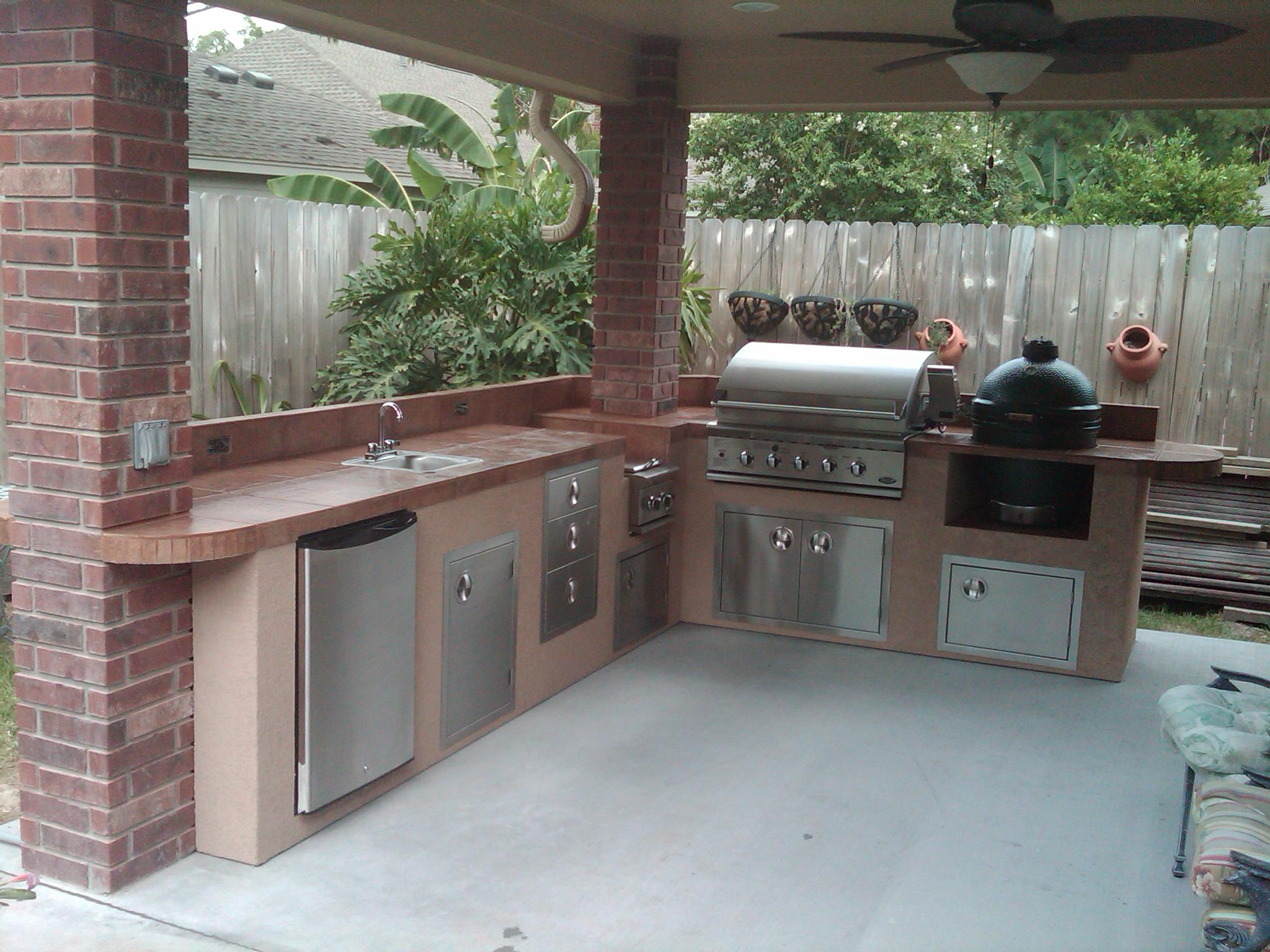 grill for outdoor kitchen french country island equipment houston gas grills under patio cover