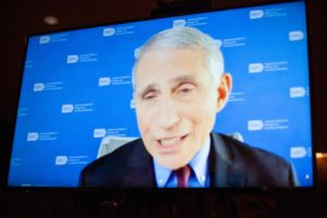 Anthony Fauci on video monitor