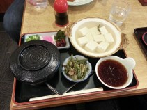 Hot soft tofu with rice and pickles.