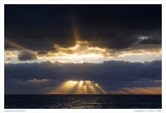 Crepuscular Rays. (Click on the photo for added detail.)