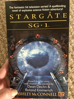 A copy of the novel Stargate SG-1 by Ashley McConnell
