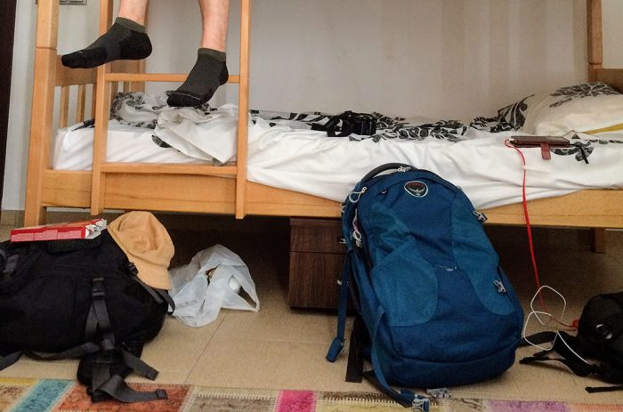 My Osprey bag among your typical hostel dorm room mess.
