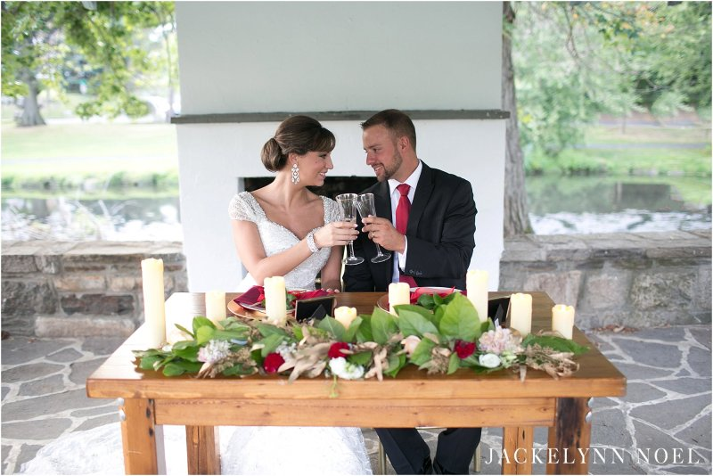 Leila and Matt toasting at a head table. Styled shoot set in Greenwich, Connecticut.
