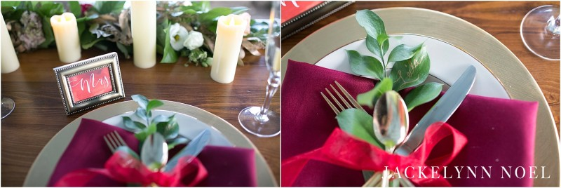 Close up of the place setting. Gold rimmed plates, gold chargers, and red napkins.