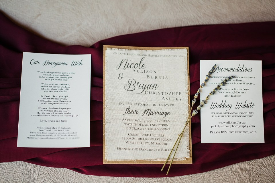 Photo of the canvas invitation and burgundy wedding colors.