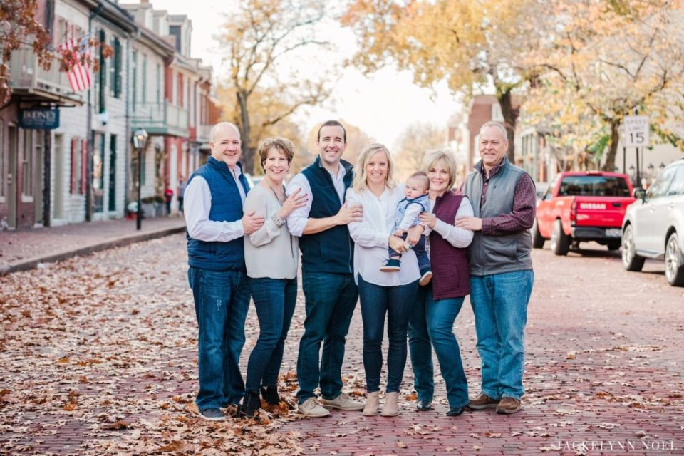 Big family photos on Main Street in St. Charles, MO by Jackelynn Noel Photography
