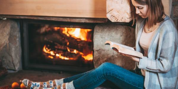 read a book by the fireplace