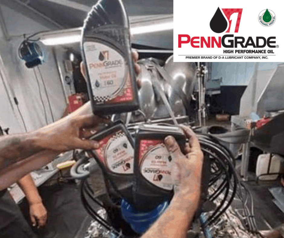 Photo of in the shop with team pouring PennGrade High Performance Oil, Oxford, AL