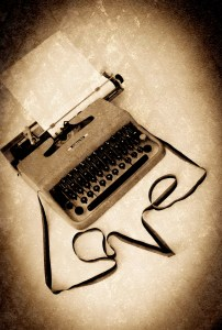 typewriter with ribbon pulled out to spell love