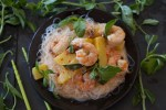 pineapple shrimp curry surrounded by Thai basil