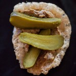 Chicken liver pate bites on pork rinds with pickles