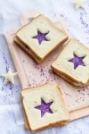fairy bread sandwiches with purple star cutouts and sprinkles