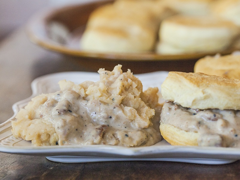 Thanksgiving recipe for spicy Southwestern mashed potatoes and gravy, served with biscuits.