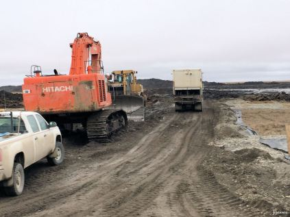 Equipment in front of the gravel pit.