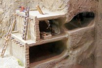This diorama shows how the dwellings were attached to the cliff and connected to the alcoves.