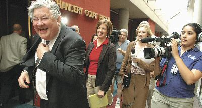 Knoxville attorney Herbert S. Moncier shows his joy at the jury verdict as the media wait to talk with him outside Chancery Court on Tuesday afternoon. Moncier represented nine Knox County citizens in the suit over the sunshine law. Photo by J. Miles Cary / Knoxville News Sentinel