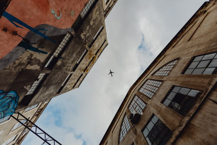 kaboompics_Buildings, sky, airplane, LX Factory, Lisbon, Portugal