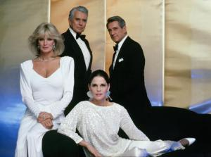 "DYNASTY - ""Photo Gallery"" which aired on December 28, 1984. (Photo by ABC Photo Archives/ABC via Getty Images) LINDA EVANS;JOHN FORSYTHE;ALI MACGRAW;ROCK HUDSON"