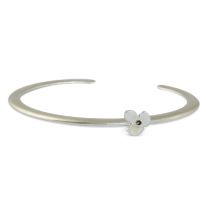 Silver cuff which features a stylised leaf design set off to one side by Jacks Turner
