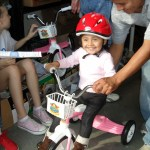 Smiling Todler on bike