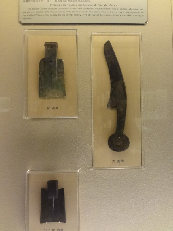 These are early examples of Chinese coins. They were actually shaped like tools, probably because metal tools had lots of value and miniature versions represented that worth.
