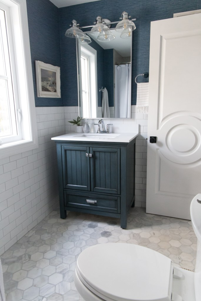 The Home Depot Lighting - Bathroom by Harper Designs - Navy vanity in a kids bathroom